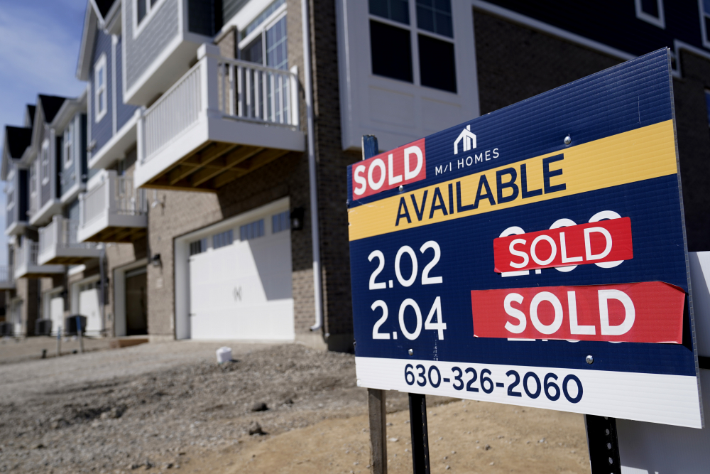 """""""Sold"""" signs sit on a lot as new home construction continue in a new neighborhood in Northbrook, Ill., Sunday, March 21."""