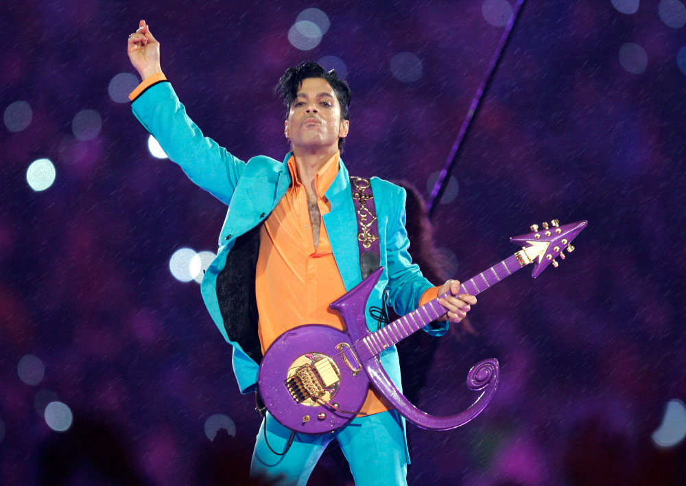 Prince performs during the halftime show at the Super Bowl XLI football game in Miami in 2007. Fans will visit Paisley Park today to mark five years since his death.