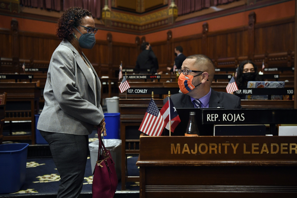 Connecticut House Majority Leader Jason Rojas, D-East Hartford, right, speaks with State Rep. Toni Walker, D-New Haven, during session at the State Capitol in Hartford, Conn. Rojas was the first person of color in the state to hold one of the top jobs in the General Assembly.
