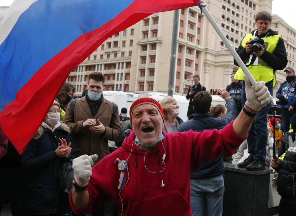A supporter waves a Russian flag and shouts slogans during the opposition rally in support of jailed opposition leader Alexei Navalny in Moscow on Wednesday.
