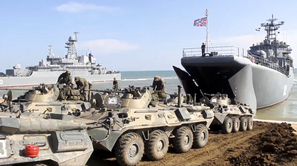 This handout photo taken from a video released on Friday by Russian Defense Ministry Press Service shows Russian military armored vehicles roll into landing vessels after drills in Crimea. Russian Defense Minister Sergei Shoigu on Thursday ordered troops back to their permanent bases after a massive military buildup that caused Ukrainian and Western concerns.