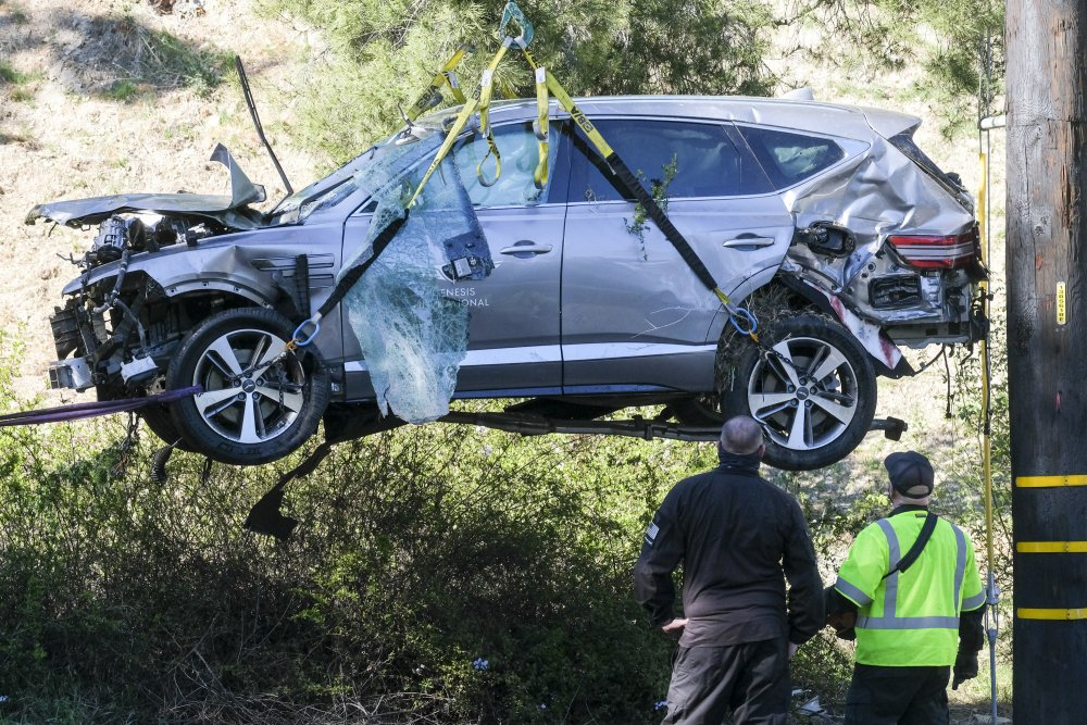 A crane is used to lift a vehicle following a rollover accident involving golfer Tiger Woods in the Rancho Palos Verdes suburb of Los Angeles on Feb. 23.