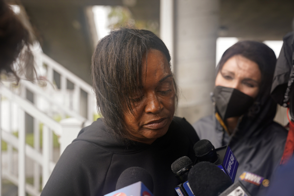 Dawn Saddler, sister of missing crewmember Gregory Walcott, talks to reporters as she leaves a briefing for family members by Coast Guard and NTSB officials in Port Fouchon, La., on Friday.