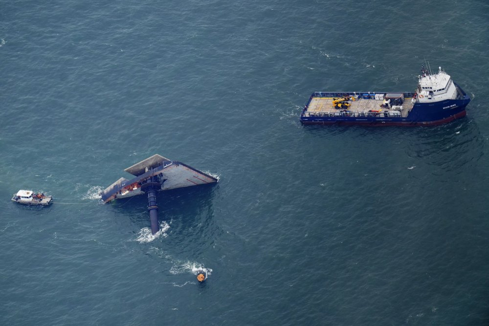 Rescue boats are seen next to the capsized lift boat Seacor Power seven miles off the coast of Louisiana in the Gulf of Mexico Sunday. The vessel capsized during a storm on Tuesday.