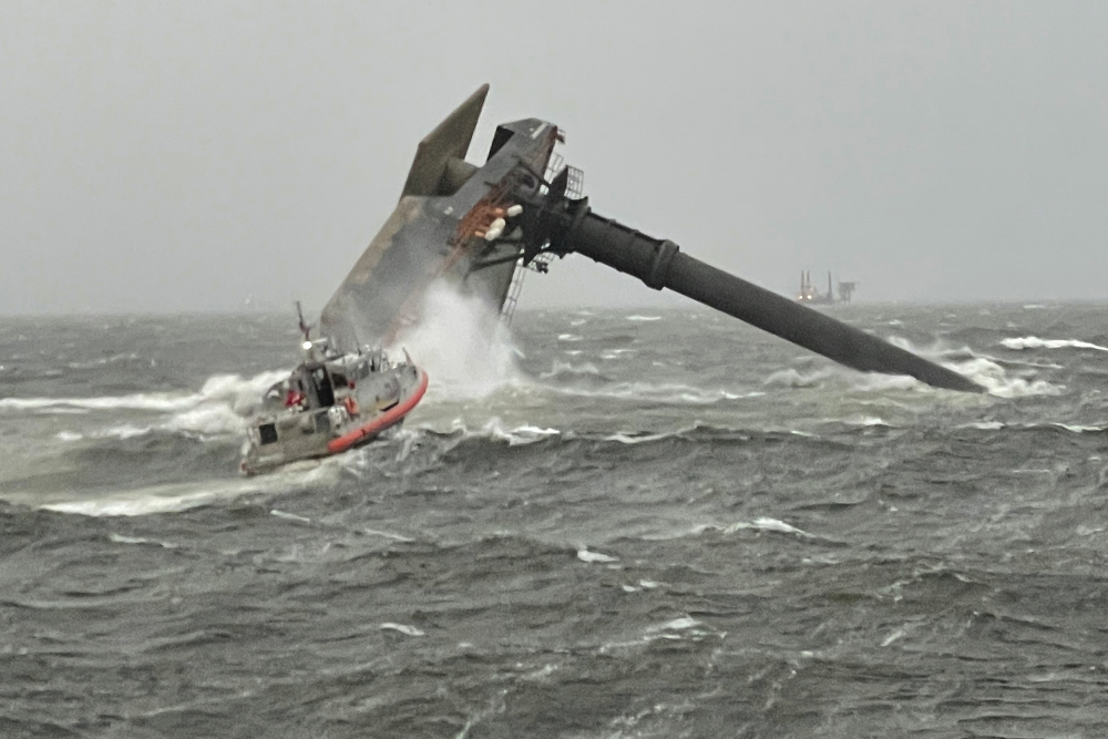 A Coast Guard Station Grand Isle response boat heads toward a capsized 175-foot commercial lift boat Tuesday, April 13, searching for people in the water 8 miles south of Grand Isle, Louisiana.