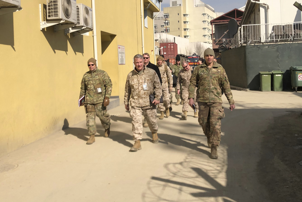 Marine Gen. Frank McKenzie, center, top U.S. commander for the Middle East, makes an unannounced visit in Kabul, Afghanistan on Jan. 31, 2020.