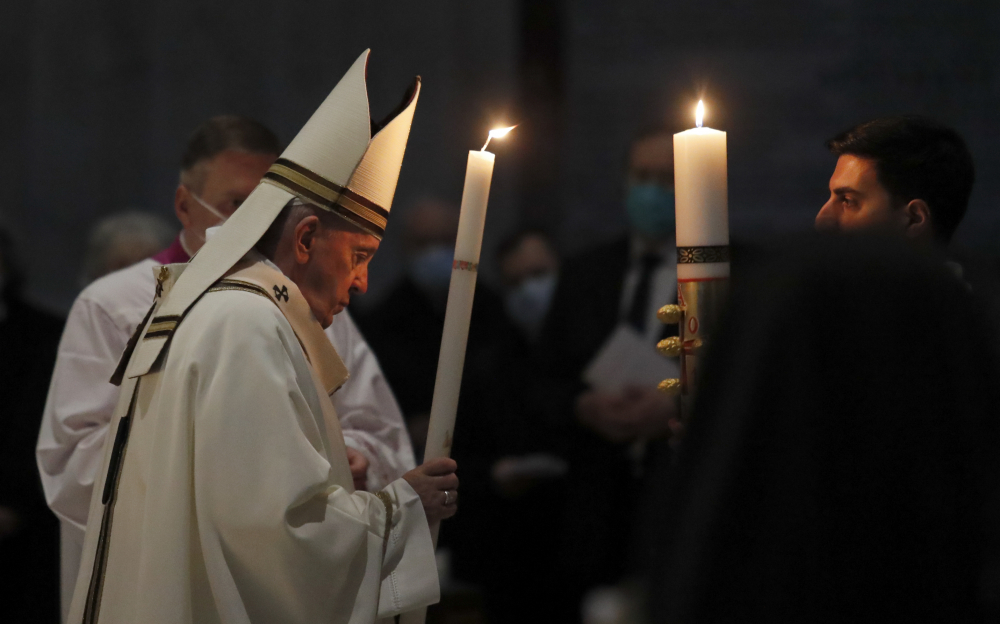 Pope Francis celebrates the Easter Vigil on Saturday in a nearly empty St. Peter's Basilica as  pandemic restrictions stay in place for a second year running, at the Vatican.