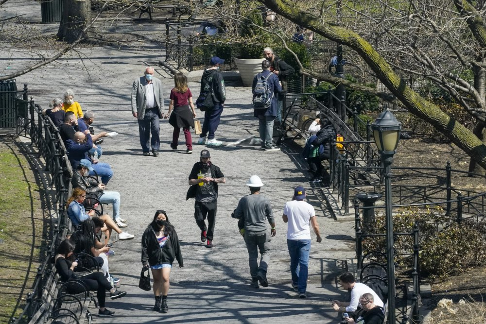 People spend lunch hour in Union Square in New York last month. Nearly half of new coronavirus infections nationwide are in just five states, including New York.
