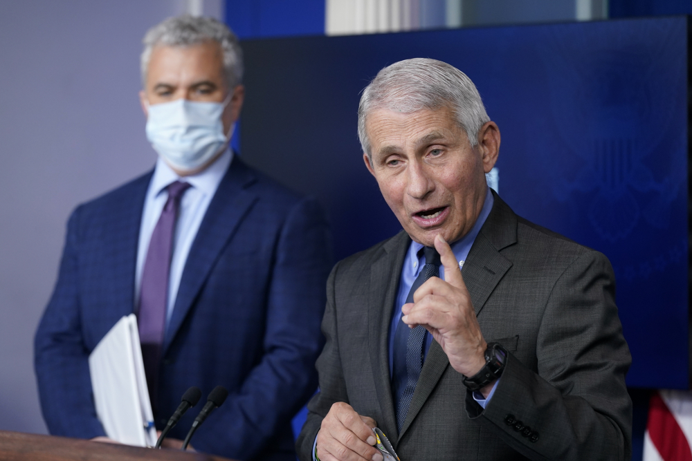 "Dr. Anthony Fauci, director of the National Institute of Allergy and Infectious Diseases, speaks alongside White House COVID-19 Response Coordinator Jeff Zients during a press briefing on Tuesday. The pause on the Johnson & Johnson vaccine is a ""testimony to how seriously we take safety,"" said Fauci."