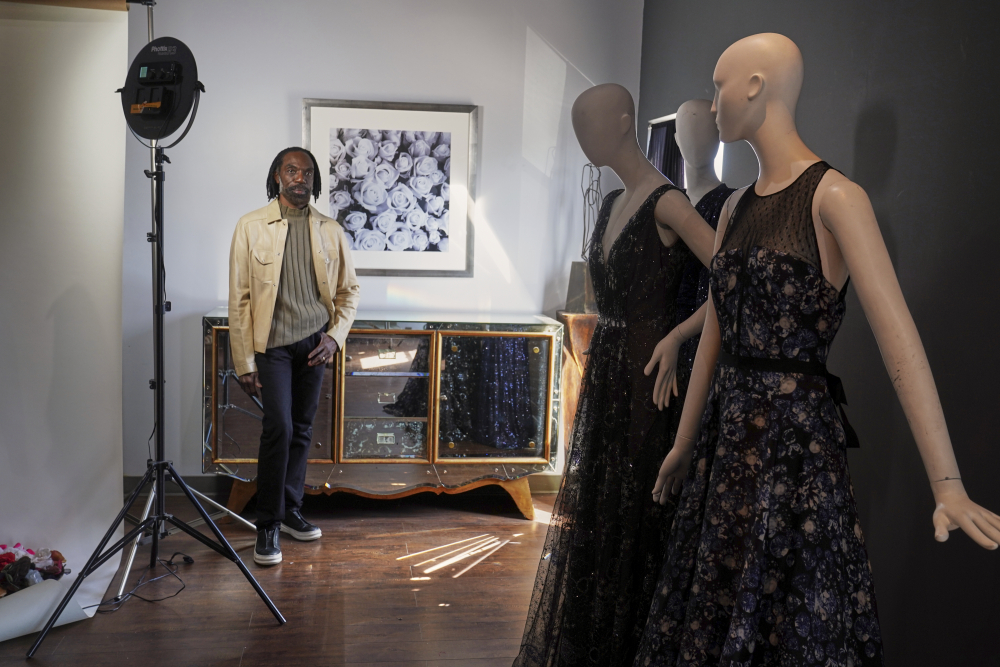 """Fashion designer Kevan Hall pauses for a picture with his """"Galaxy Collection"""" at his haute couture atelier in West Los Angeles on Thursday. A year ago, Hall quickly moved away from his trademark gowns and cocktail dresses to caftans, tunics and pull-on pants. Now Hall is adding back some dressier looks, but he's eliminating the full skirts and scaling back the beading in favor of simple gowns and dresses in knit and tulle fabrics."""