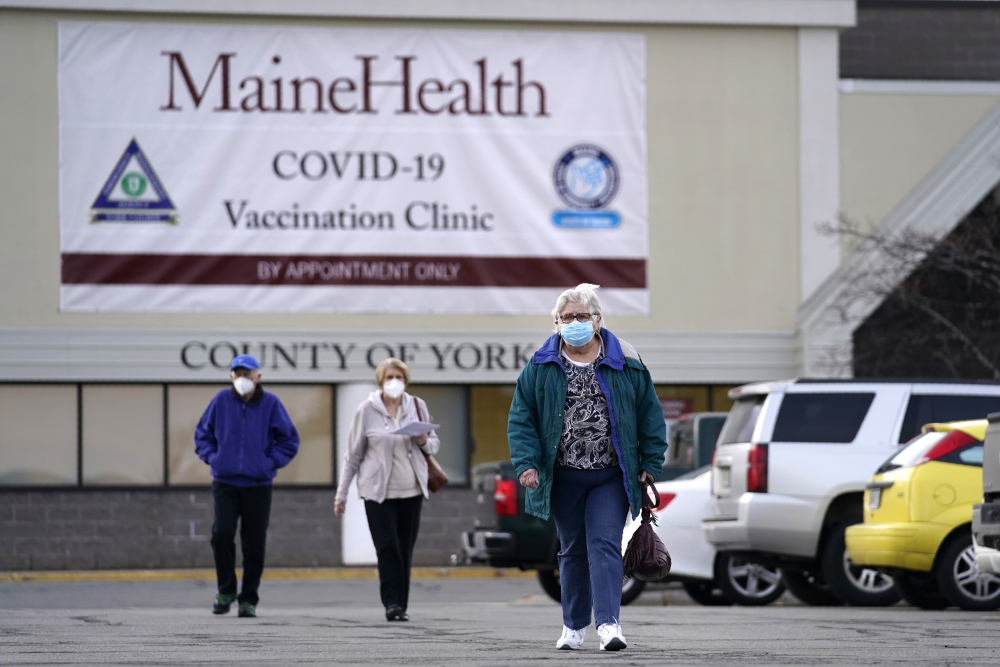 Senior citizens leave a COVID-19 vaccination site operated by Maine Health in the site of a former department store in Sanford.