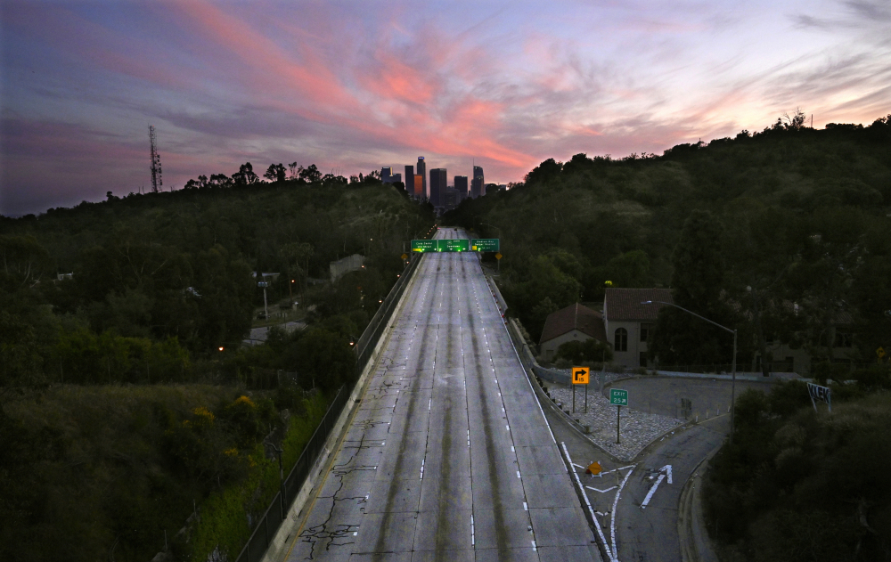 The 110 Arroyo Seco Parkway that leads to downtown Los Angeles is empty on April 26, 2020. A U.S. intelligence community report released Tuesday says the pandemic has already disrupted crucial health services in certain areas of the world and will lead to continued health emergencies, and it has raised tensions as countries compete for advantage.