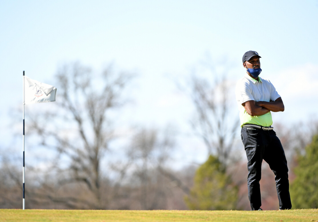 Howard University golf coach Sam Puryear looks on during practice at Woodmont Country Club in Rockville, Md.