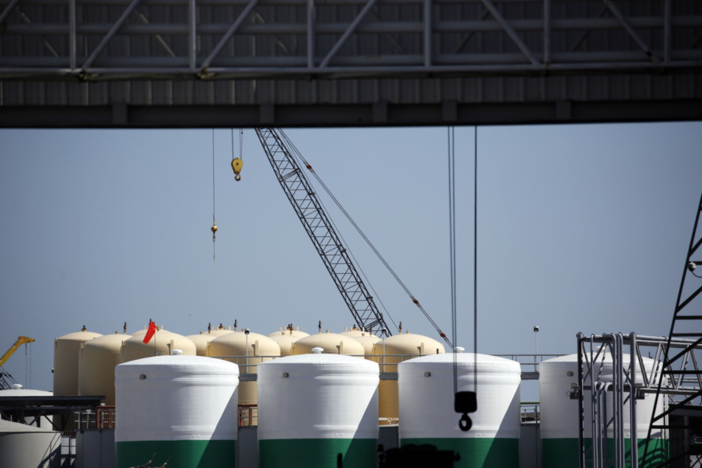 Storage tanks and cranes stand at an oil industry support facility in Port Fourchon, La., on June 11, 2020. In the U.S., the inventory pile-up has effectively cleared already, with stockpiles of crude and products subsiding in late February.