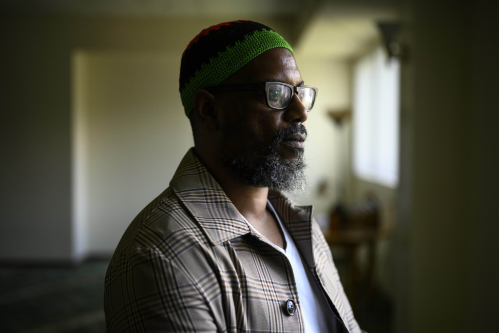 Karim Amin, 43, in the prayer room of his mosque, the Gwynn Oak Islamic Community, in Baltimore. Before Ramadan begins Tuesday, Amin is navigating a host of decisions including whether and where to listen to the nightly taraweeh prayer, how close to stand to others if he goes in person and how many people to break fast with.