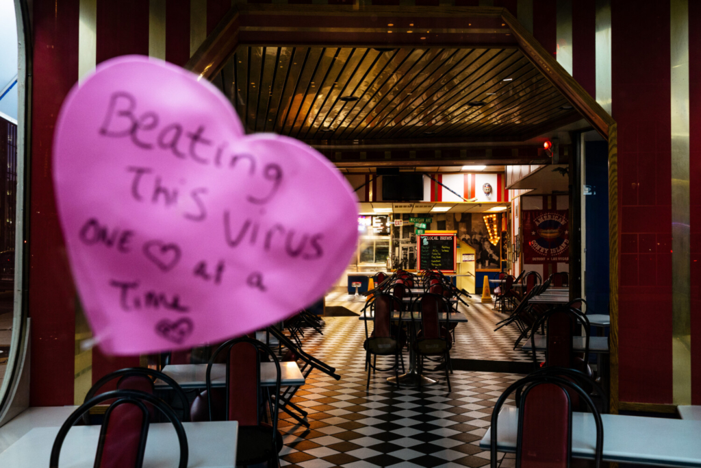 A heart emblazoned with a hopeful message appears at American Coney Island in Detroit. The popular tourist site is closed during Michigan's stay-at-home order during a coronavirus surge.