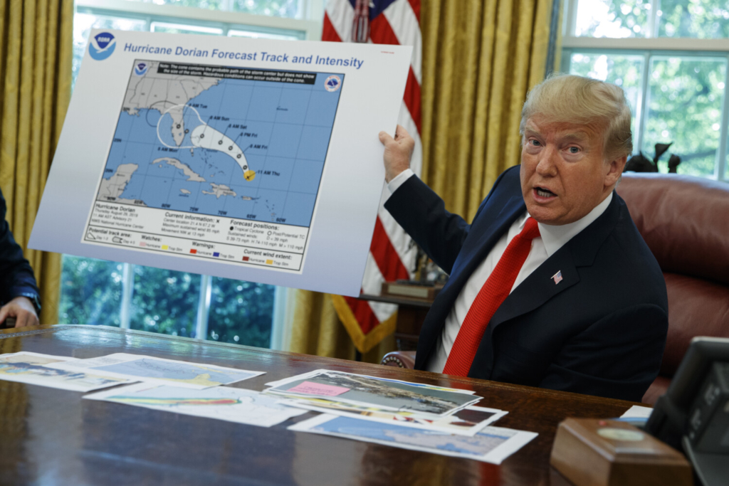 President Donald Trump talks with reporters after receiving a briefing on Hurricane Dorian on Sept. 4, 2019. A new 46-person federal scientific integrity task force with members from dozens of government agencies will meet for the first time Friday. The effort was spurred by concerns that the Trump administration had politicized science in ways that put lives at risk.