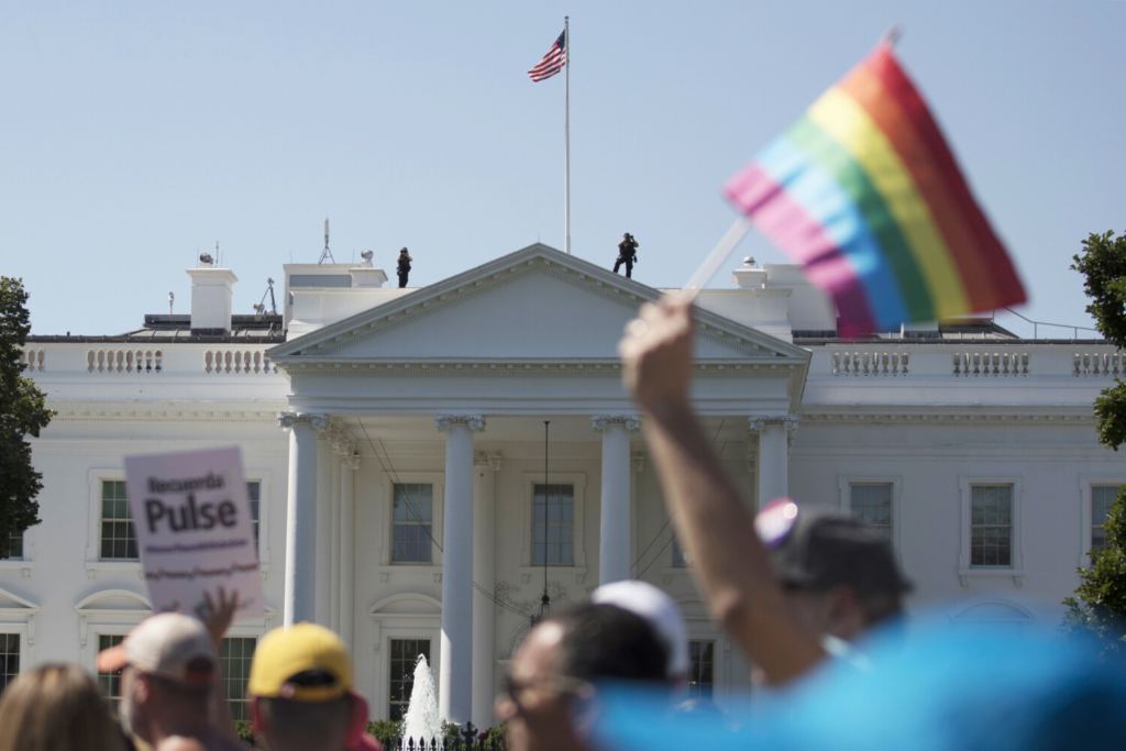 Equality March for Unity and Pride participants march past the White House on June 11, 2017.  The Biden administration says the government will protect gay and transgender people against sex discrimination in health care, reversing a Trump-era policy.
