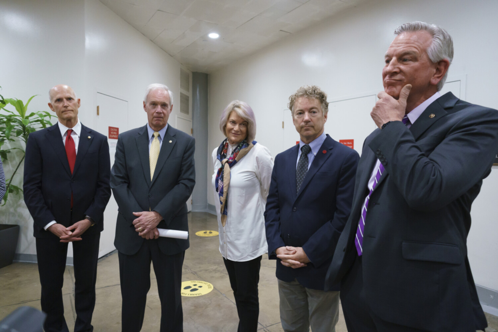 Republican senators, from left, Rick Scott, R-Fla., Ron Johnson, R-Wis., Cynthia Lummis, R-Wyo., Rand Paul, R-Ky., and  Tommy Tuberville, R-Ala., talk to reporters at the Capitol in Washington on Friday.