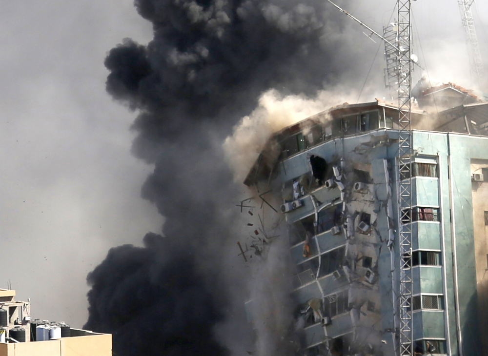 The building housing the offices of The Associated Press and other media in Gaza City collapses after it was hit by an Israeli airstrike Saturday, May 15. The attack came roughly an hour after the Israeli military warned people to evacuate the building, which also housed Al-Jazeera and a number of offices and apartments.