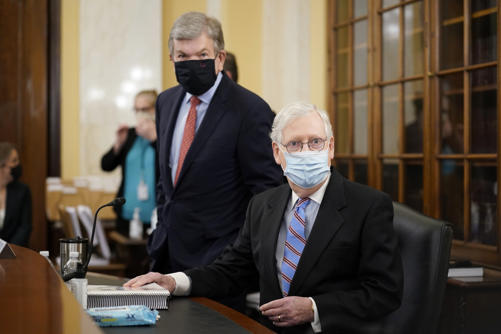 Senate Minority Leader Mitch McConnell of Ky., right, and Sen. Roy Blunt, R-Mo., arrive for a Senate Rules Committee hearing at the Capitol in Washington, Tuesday, May 11.