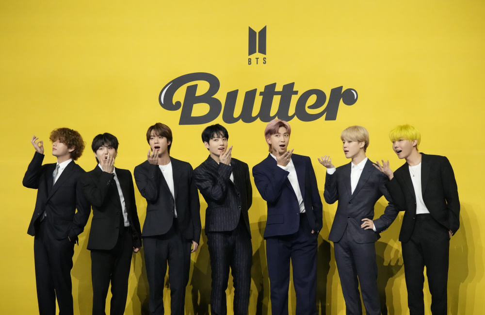 """Members of South Korean K-pop band BTS pose for photographers ahead of a press conference to introduce their new single """"Butter"""" in Seoul, South Korea, Friday, May 21, 2021."""