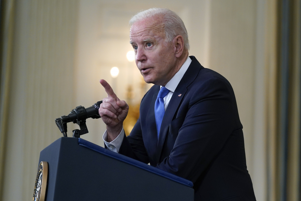 President Biden speaks to reporters at the White House on Wednesday. His administration is supporting efforts to waive intellectual property protections for COVID-19 vaccines in an effort to speed the end of the pandemic.