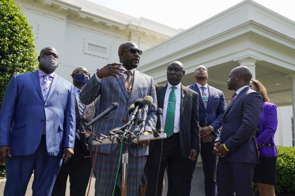 Philonise Floyd, the brother of George Floyd, talks with reporters as he stands with other family members after meeting with President Biden at the White House on Tuesday in Washington.