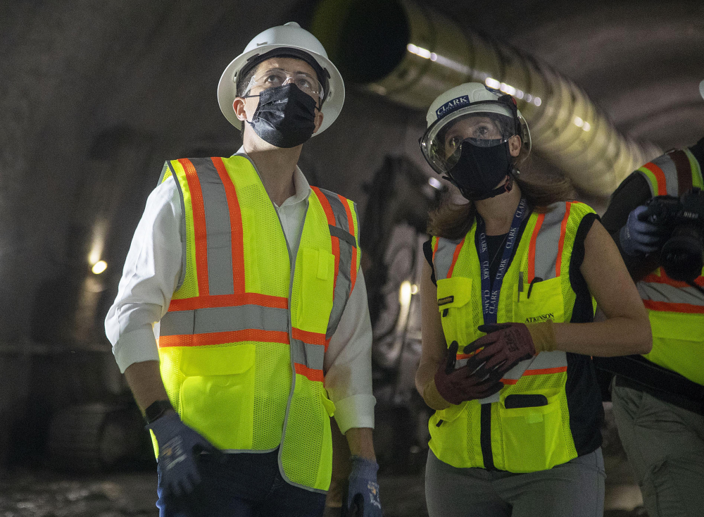 Construction project manager Gabrielle Ferro, second right, speaks with U.S. Secretary of Transportation Pete Buttigieg, during a tour of an underground tunnel for the expansion of the Hartsfield–Jackson Atlanta International Airport train tunnel May 21.