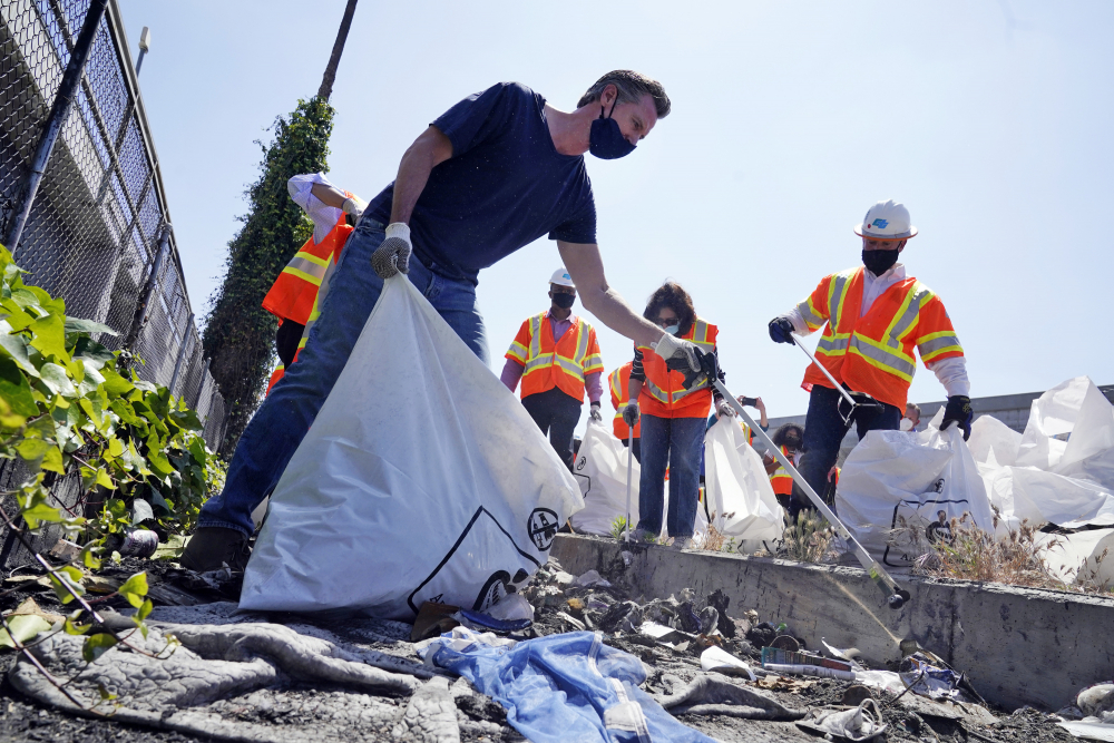 California Gov. Gavin Newsom joins a cleanup effort May 11 in Los Angeles.