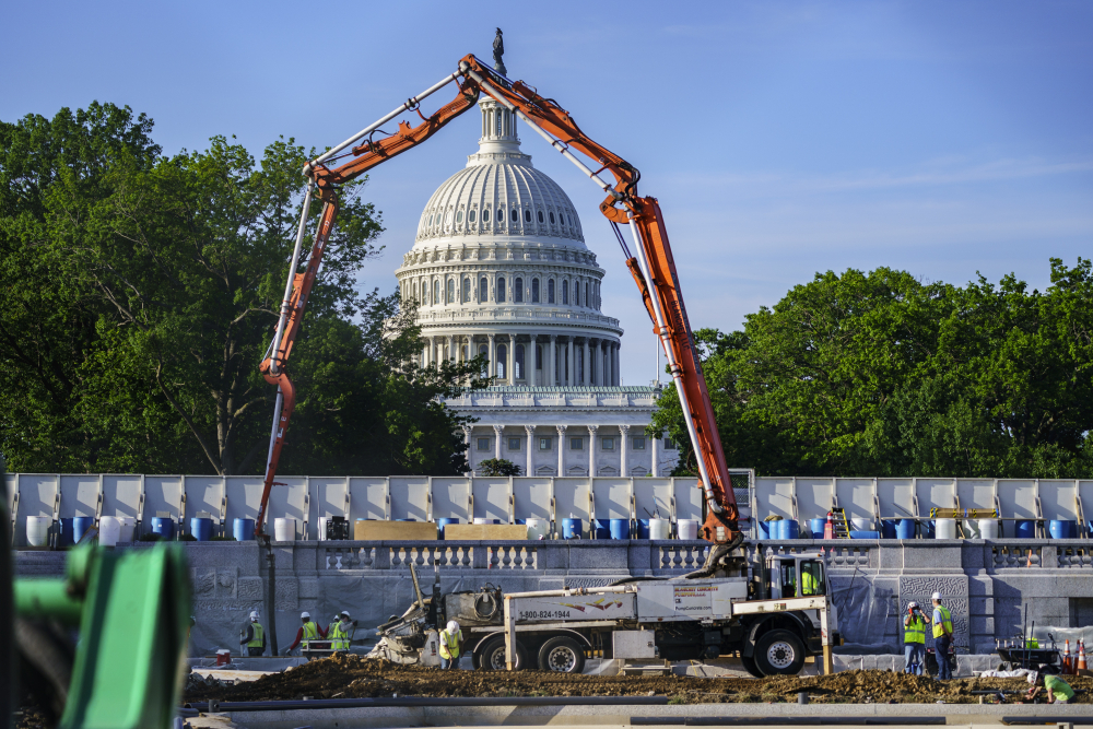 A concrete pump frames the Capitol Dome during renovations and repairs to Lower Senate Park on Capitol Hill in Washington in May.