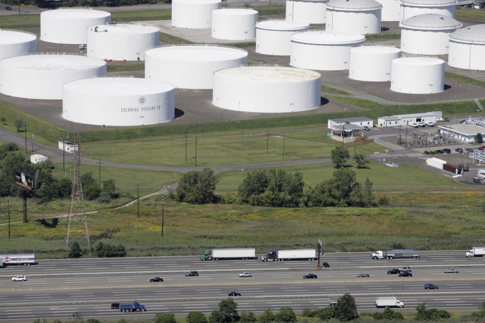 Traffic on I-95 passes oil storage tanks owned by the Colonial Pipeline Company in Linden, N.J., in 2008. Friday's incident was the worst cyberattack to date on critical U.S. infrastructure.