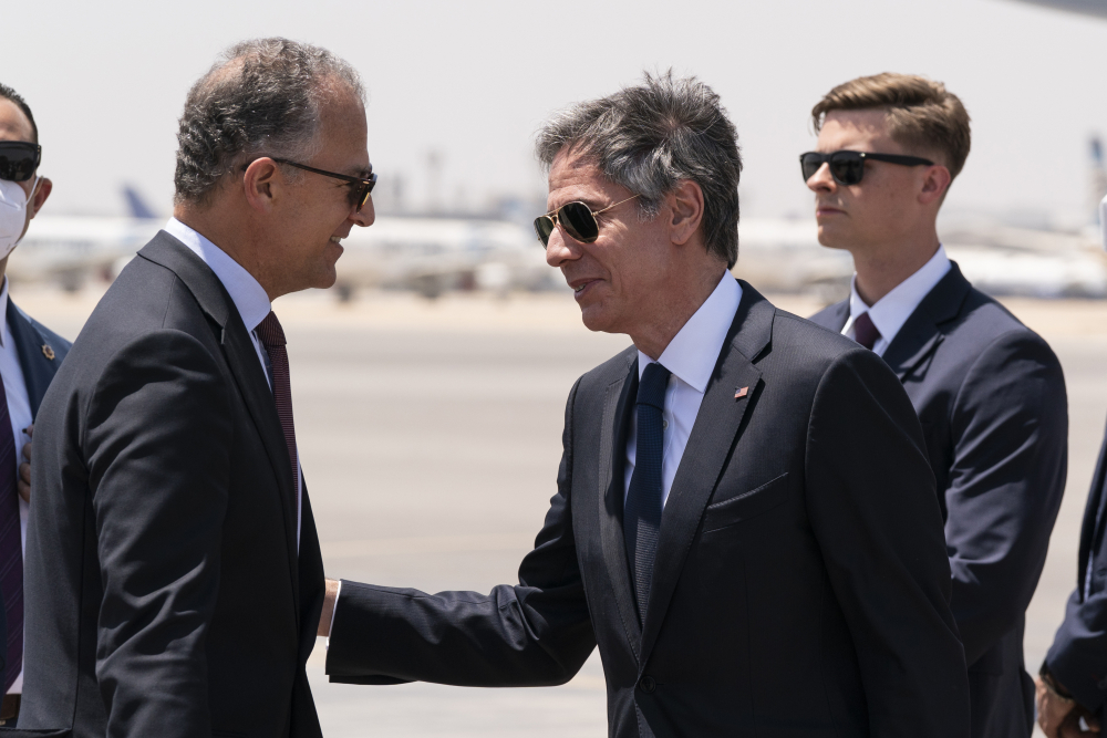Secretary of State Antony Blinken, second from right, is greeted by U.S. Ambassador to Egypt Jonathan Cohen upon arrival at Cairo International Airport on Wednesday in Cairo, Egypt.