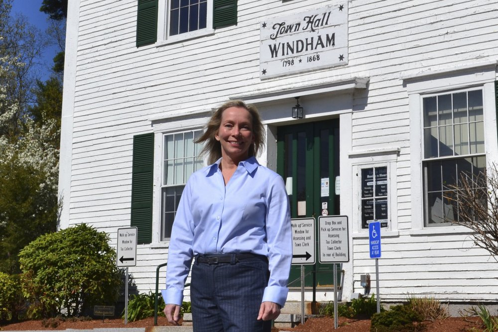 Kristi St. Laurent, who ran for a House seat in the 2020 election, poses in front of Town Hall May 7 in Windham, N.H. St. Laurent, who requested a recount after losing the 2020 election by 24 votes, has led to a debate over the integrity of the election in Windham and prompted Trump supporters to suggest the dispute could illustrate wider problems with the election system.