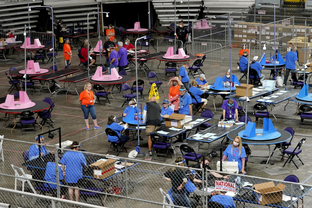 Maricopa County ballots cast in the 2020 general election are examined and recounted by contractors working for a Florida-based company, Cyber Ninjas, at Veterans Memorial Coliseum in Phoenix this month. For some conspiracy theorists, the 2020 election still hasn't ended. Trump supporters are pushing to re-examine ballots from November across the country. Their efforts and sometimes misleading conclusions are being gleefully amplified by the former president.