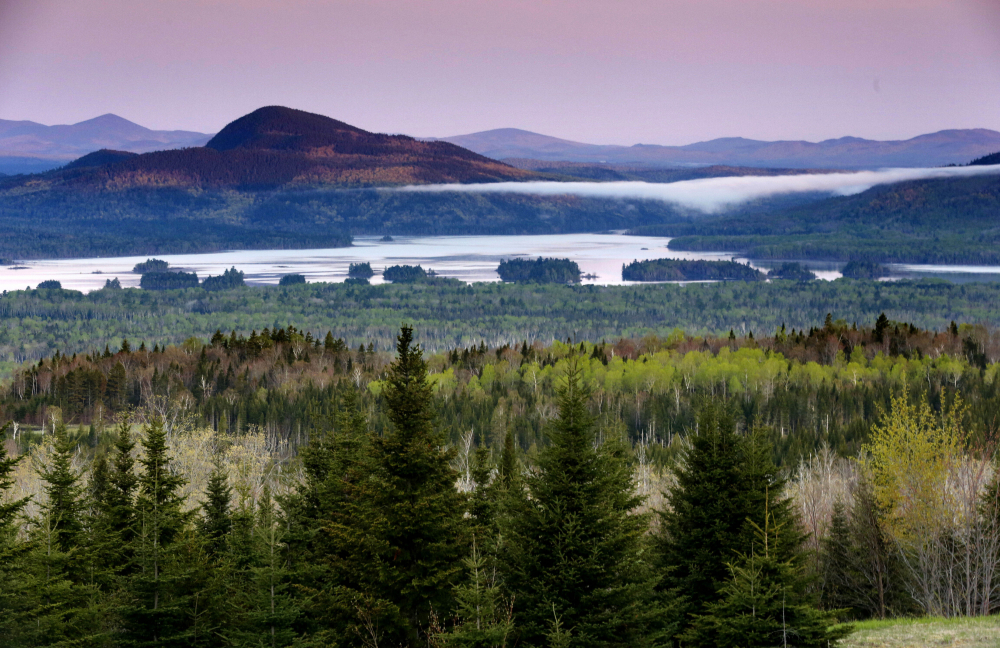 Central Maine Power's hydropower transmission corridor would be in the vicinity of this view of Attean Pond near Jackman, as seen from a scenic pullover. A 54-foot-wide swath of land would extend 53 miles from the Canadian border into Maine's north woods.