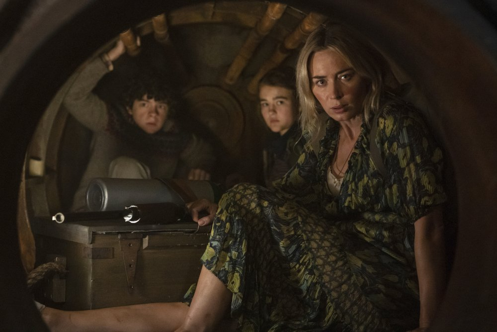 """Noah Jupe, from left, Millicent Simmonds and Emily Blunt in a scene from """"A Quiet Place Part II."""""""