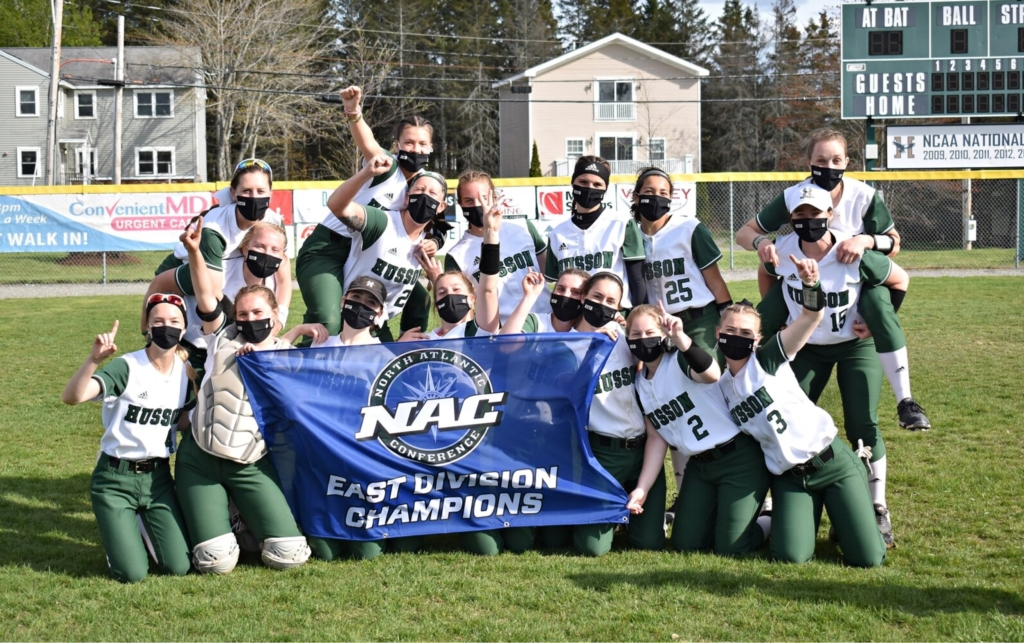 The Husson softball team celebrates after winning the North Atlantic Conference East Division title last weekend in Bangor. The Eagles, with a 25-1 record, play Cazenovia for the NAC title this weekend in New York.