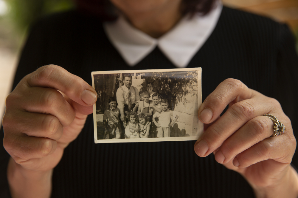 Samira Dajani holds a photo of her family in 1956 after they moved into their home in the Sheikh Jarrah neighborhood of east Jerusalem, Sunday. The Dajanis are one of several Palestinian families facing imminent eviction in the Sheikh Jarrah neighborhood of east Jerusalem.