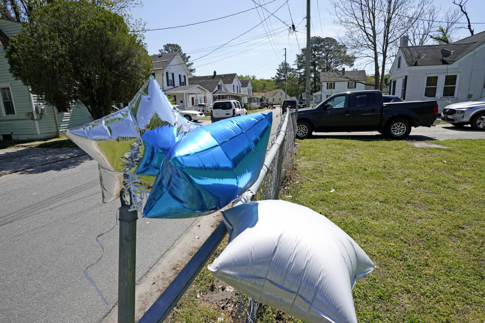 Balloons are seen tied to a fence April 22 in Elizabeth City, N.C.