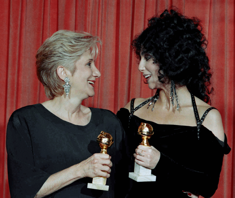 """Olympia Dukakis. left,  and Cher hold the awards they received for performances in the hit movie """"Moonstruck"""" at the Beverly Hilton Hotel in 1988."""