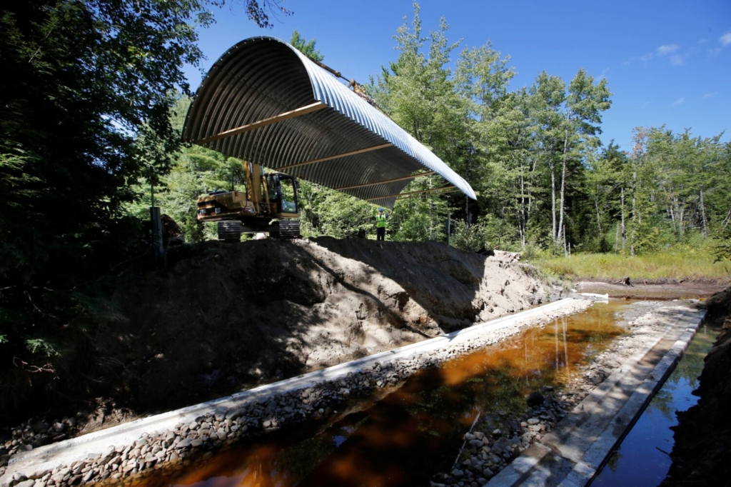 Workers install an open-bottom arch culvert on the Passadumkeag River in September 2014. A $7 million grant from the U.S. Department of Agriculture will help restore some of Maine's highest-value aquatic networks from fragmentation and degradation by improving roadway stream crossings.