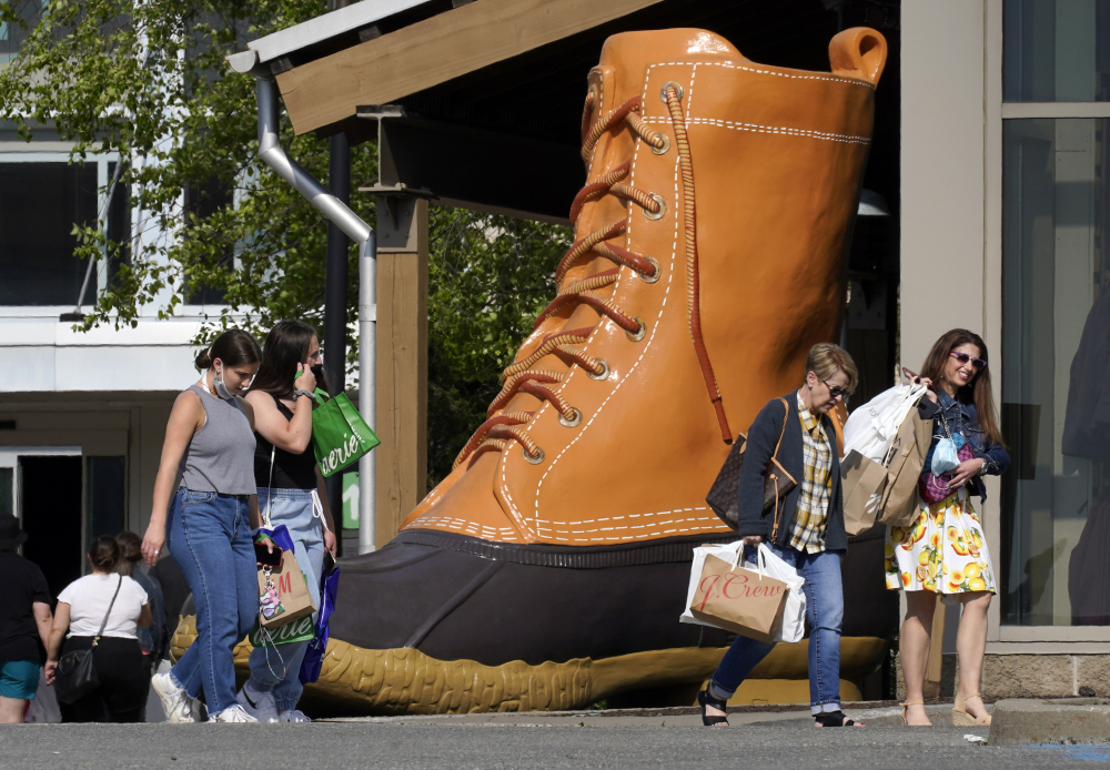 Shoppers walk past a giant L.L. Bean boot outside the Ross Park Mall in Pittsburgh on Sunday.