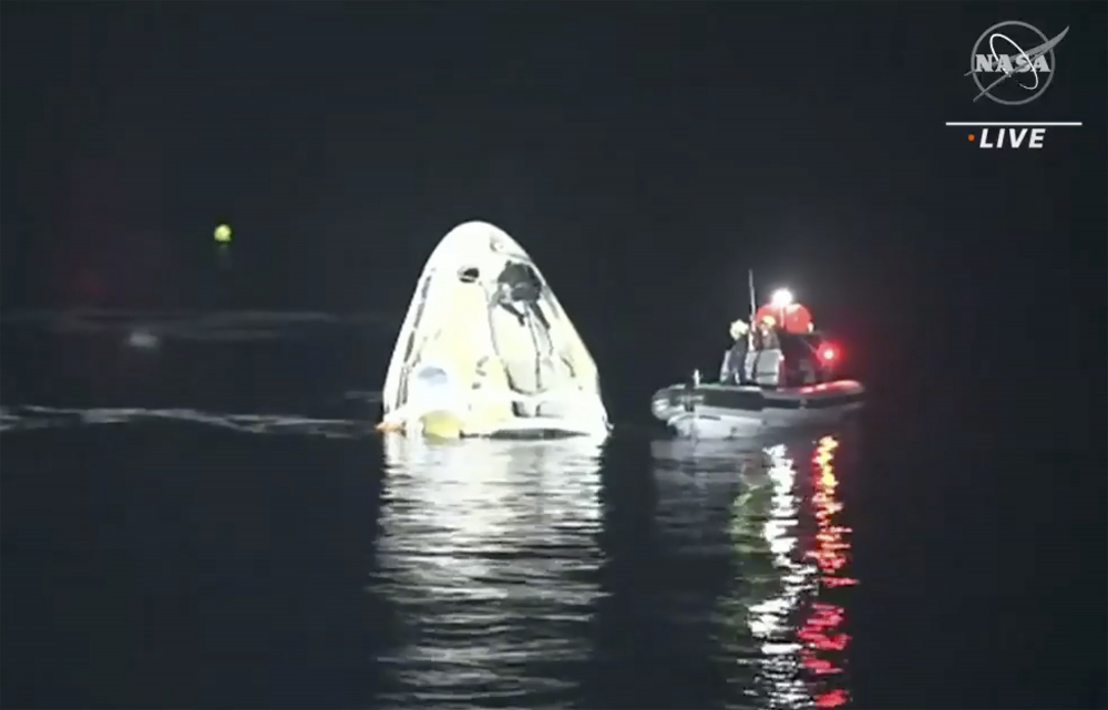 The SpaceX Dragon capsule floats after landing in the Gulf of Mexico near the Florida Panhandle early Sunday. SpaceX returned four astronauts from the International Space Station on Sunday, making the first U.S. crew splashdown in darkness since the Apollo 8 moonshot.