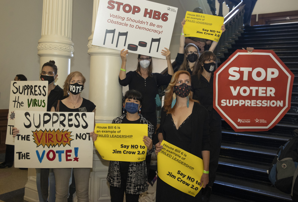 People gather outside the House Chamber at the Capitol in Austin on Thursday  to protest House Bill 6, a bill that would create new election-related crimes, boost penalties for existing crimes and raise the profile of partisan poll watchers.