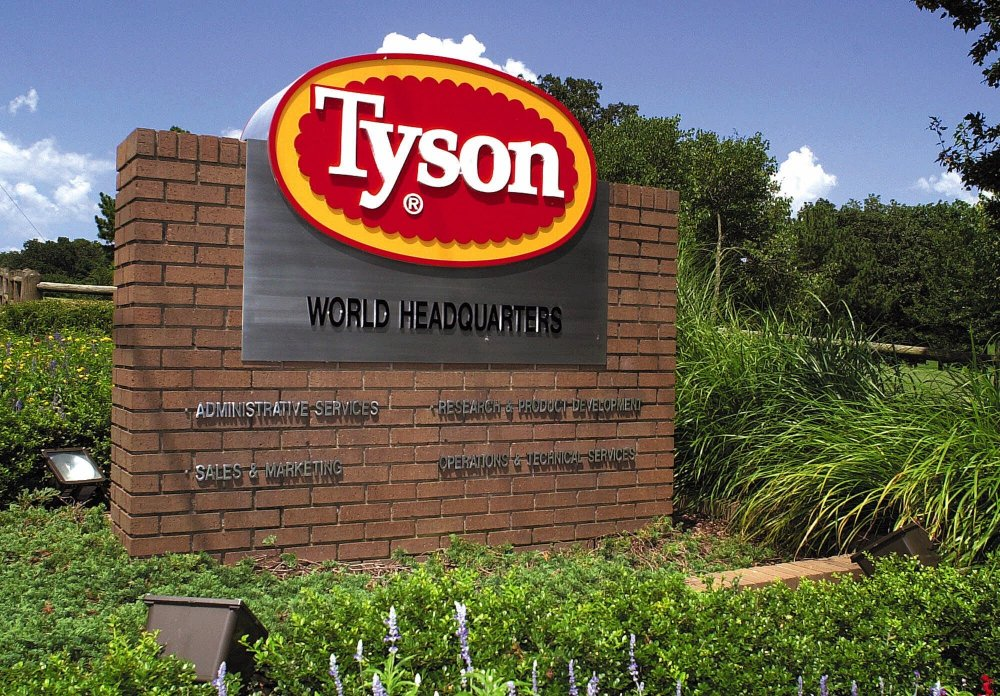 A sign marks the entrance to Tyson Foods headquarters in Springdale, Ark., in 2001. The company said Monday that absentee rates are around 50 percent higher than they were before the pandemic.
