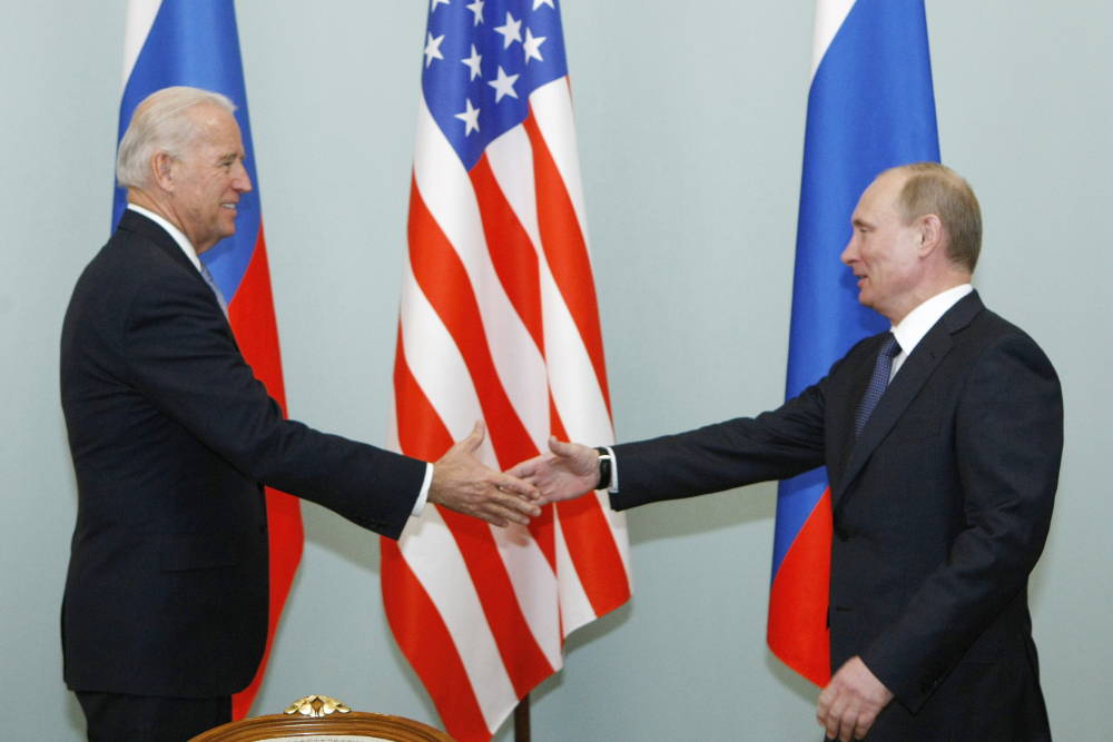 Then-Vice President Joe Biden, left, shakes hands with Russian Prime Minister Vladimir Putin in Moscow, Russia on March 10, 2011. Biden will hold a summit with Vladimir Putin next month in Geneva.