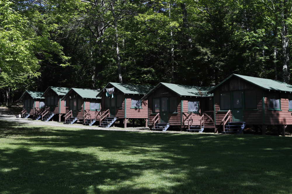 The U.S. Centers for Disease Control and Prevention on Friday posted guidance saying kids at summer camps, such as this one in Fayette, Maine, can skip wearing masks outdoors, with some exceptions.