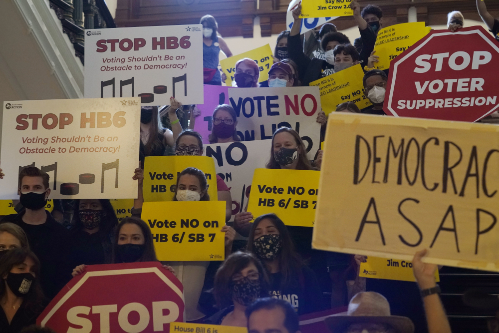A group opposing new voter legislation gathers May 6 outside the House chamber at the Texas Capitol in Austin.