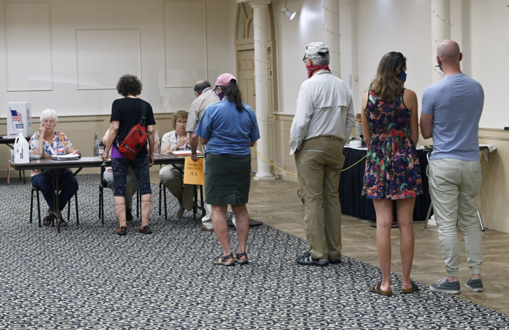 A line of people waiting to vote for the charter commission election at the Italian Heritage Center in Portland on Tuesday.
